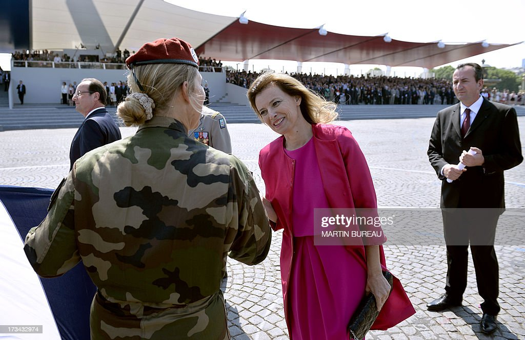 French President's partner, Valerie Trierweiler arrives for the Bastille Day parade at the Place de la Concorde, on July 14, 2013 in Paris.