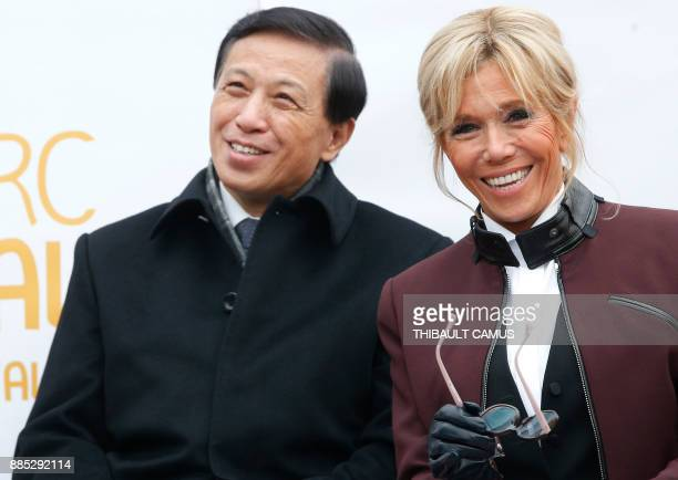 French president's wife Brigitte Macron and and Chinese Vice Foreign minister Zhang Yesui attend a naming ceremony for a panda born at the Beauval...