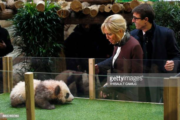 French president's wife Brigitte Macron and Director of the Beauval Zoo Rodolphe Delord attend a naming ceremony for a panda born at the Beauval zoo...