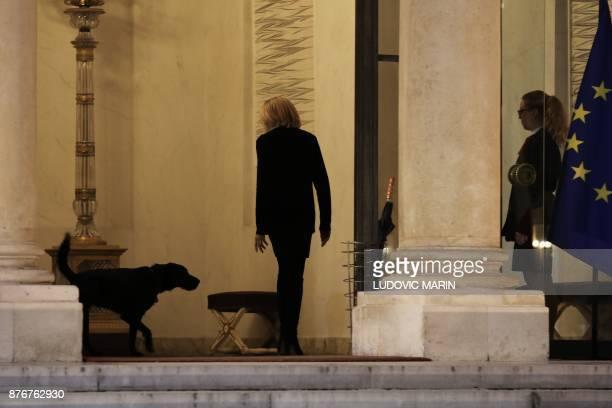 French President's wife Brigitte Macron is followed by presidential dog Nemo after meeting with children accompanied by the United Nations' agency...