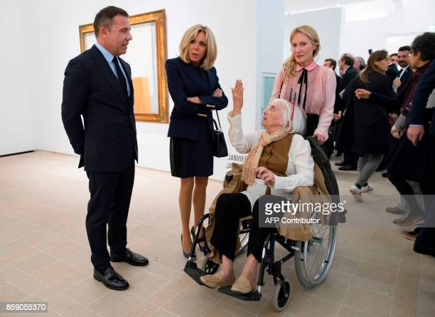 French President's wife Brigitte Macron talks with daughter of late Spanish painter Pablo Picasso Maya Picasso her son Olivier Widmaier Picasso and...