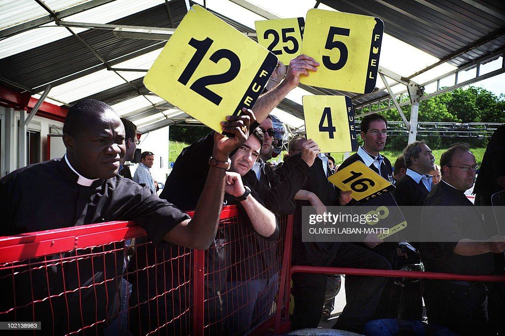 French priests take part in the third edition of the 'Padre cup', a priest's karting race championship on June 7, 2010 at the Jean-Pierre Beltoise's karting track in Trappes, near Paris. Seventy priests challenged each other today for several hours in a race where each tour brought one euro to charity, paid by spectators and sponsors.