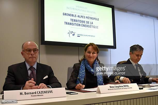 French Prime Minister Bernard Cazeneuve and French Minister for Ecology Sustainable Development and Energy Segolene Royal sign documents regarding...