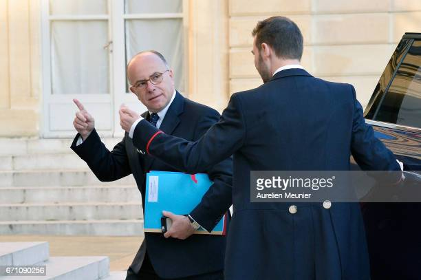 French Prime Minister Bernard Cazeneuve arrives at Elysee Palace for a defense council on April 21 2017 in Paris France One police officer has been...