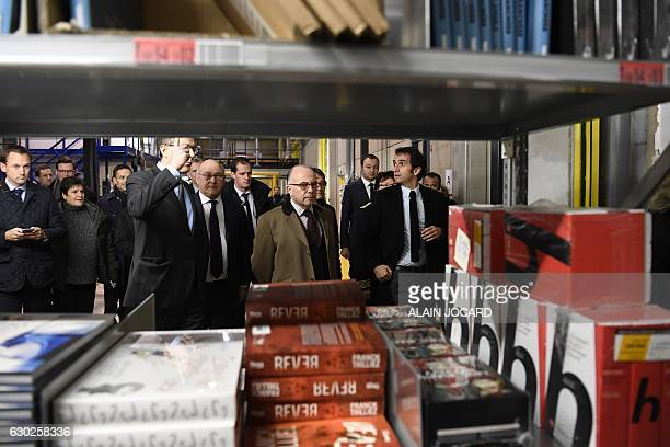 French Prime Minister Bernard Cazeneuve French Finance and Economy Minister Michel Sapin and French retail chain FNAC chairperson Alexandre Bompard...