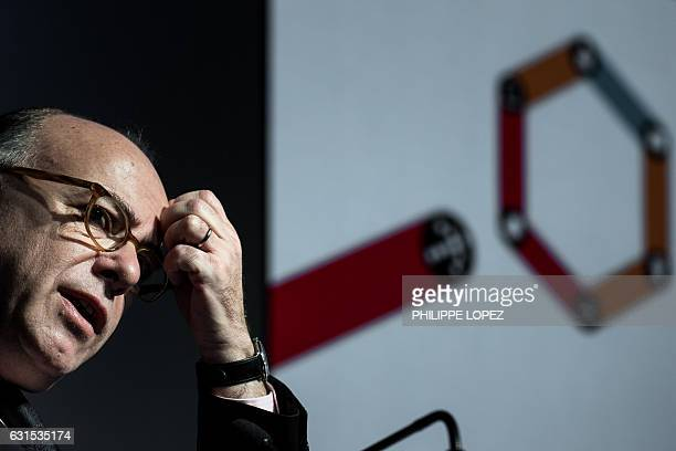 French Prime Minister Bernard Cazeneuve gestures during the unveiling of the 'compte personnel dactivite' in Paris on January 12 2017 in Paris / AFP...