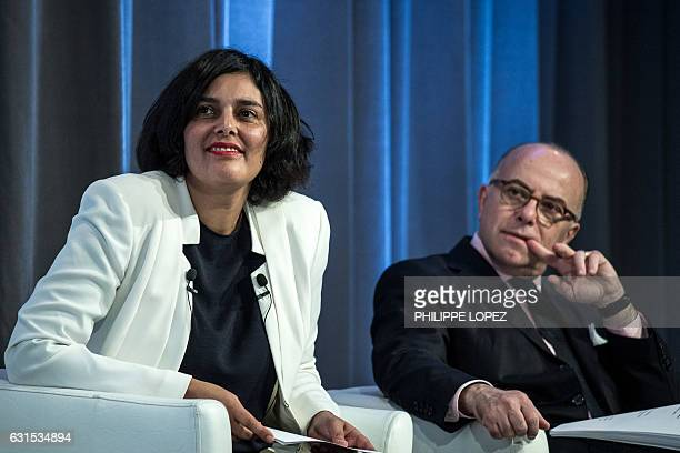 French Prime Minister Bernard Cazeneuve looks on next to French Labour Minister Myriam El Khomri during the unveiling of the 'compte personnel...