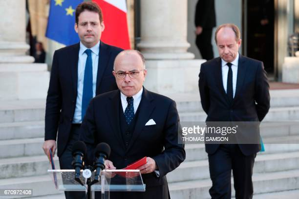 TOPSHOT French Prime Minister Bernard Cazeneuve speaks next to Interior Minister Matthias Fekl and Justice Minister JeanJacques Urvoas after a...