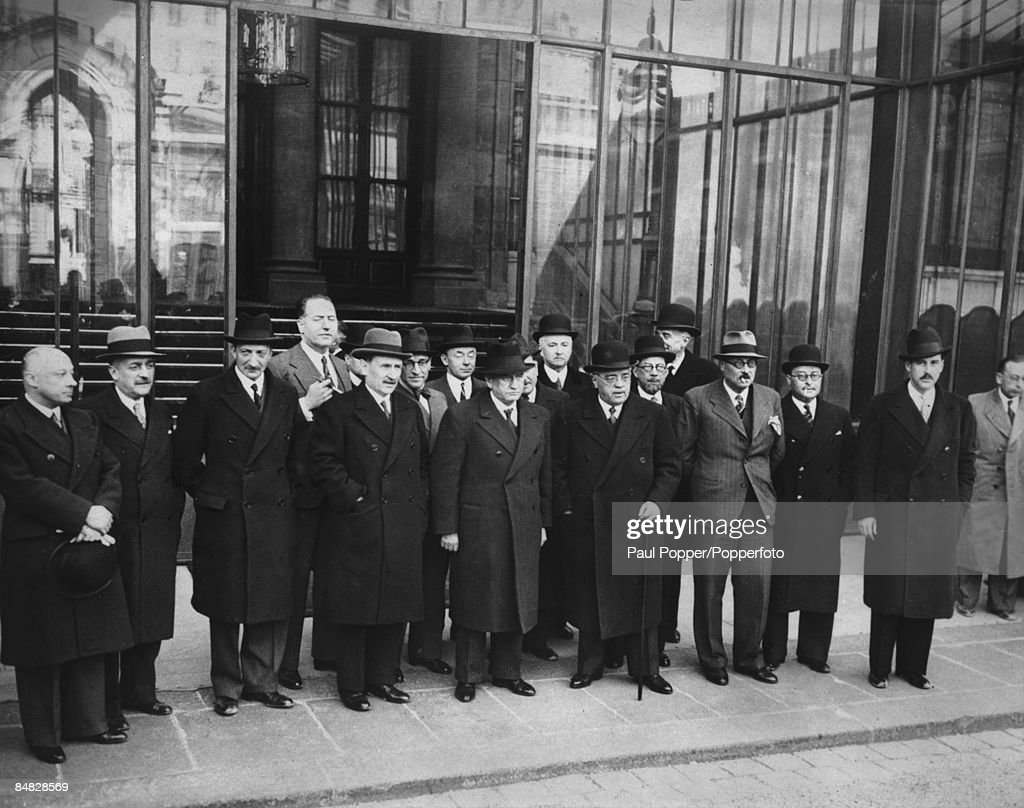 French Prime Minister Edouard Daladier (1884-1970) with members of the newly-formed cabinet for his Third Ministry, 10th April 1938. Left to right: Minister of Public Health Marc Rucart, Minister of Agriculture Henri Queuille, Foreign Minister Georges Bonnet (1889 - 1973), Minister of National Economy Raymond Patenotre, Vice President of the Council Camille Chautemps, Navy Minister Cesar Campinchi (1882 - 1941), Minister of Justice Paul Reynaud (1878 - 1966), Daladier, Minister of Veterans and Pensioners Auguste Champetier de Ribes, Minister of the Interior Albert Sarraut, Minister of Commerce Fernand Gentin, Minister of Public Works Ludovic-Oscar Frossard, Minister of National Education <a gi-track='captionPersonalityLinkClicked' href=/galleries/search?phrase=Jean+Zay&family=editorial&specificpeople=1474639 ng-click='$event.stopPropagation()'>Jean Zay</a> and Air Minister Guy La Chambre.