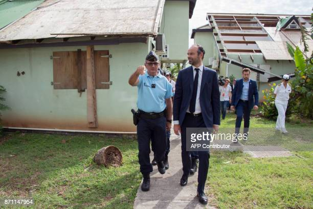 French Prime minister Edouard Philippe accompanied by a Gendarme of the Compagnie de reserve de Territoire visits damaged houses in Quartier...
