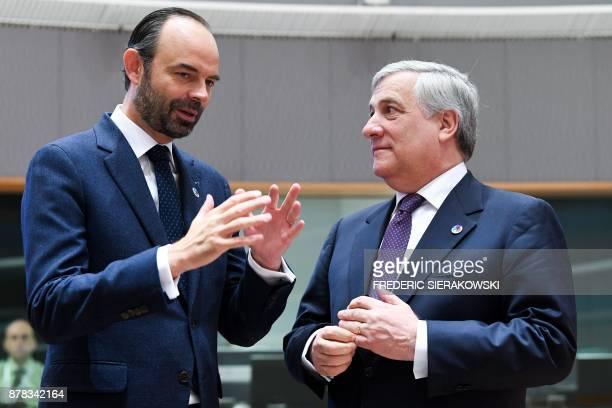 French Prime Minister Edouard Philippe and European Parliament President Antonio Tajani speak during a meeting of an EU Eastern Partnership summit...