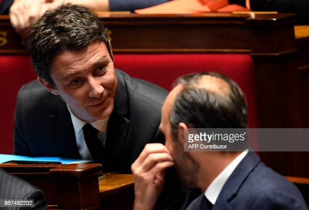 French Prime Minister Edouard Philippe and French Junior Economy Minister Benjamin Griveaux speak during session of questions to the government on...