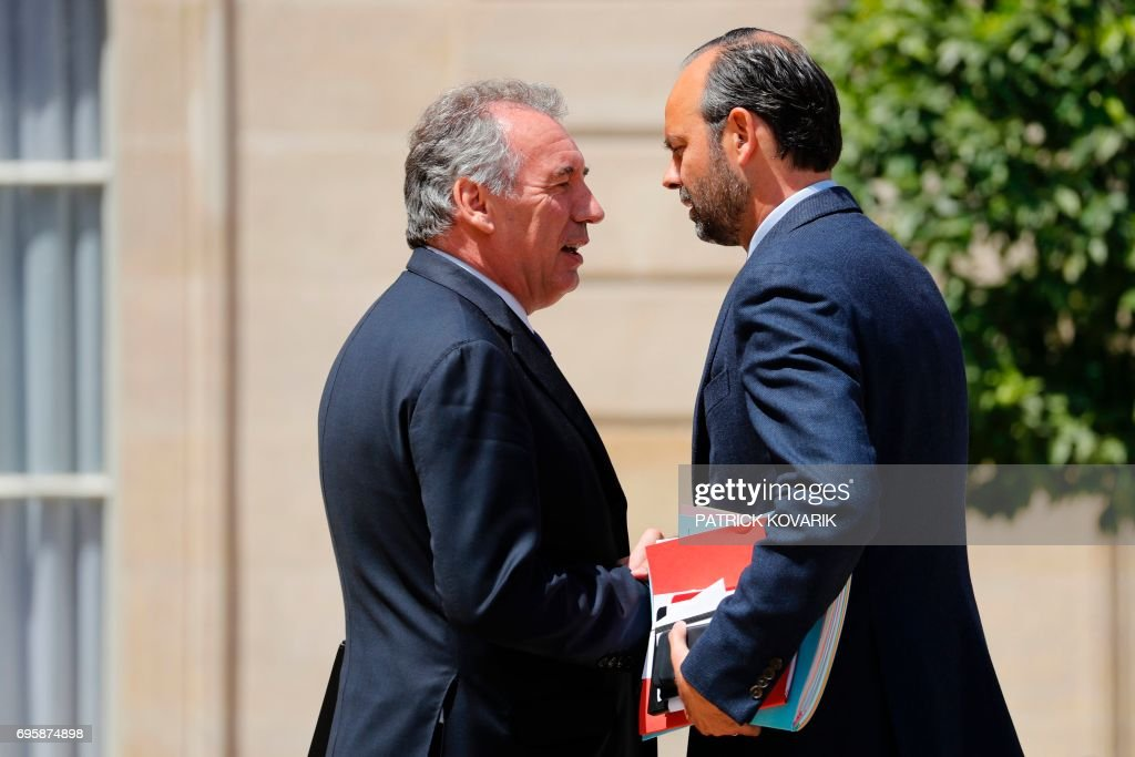 French Prime Minister Edouard Philippe (R) and French Minister of Justice Francois Bayrou (L) speak as they leave a cabinet meeting on June 14, 2017 at the Elysee Palace, in Paris. / AFP PHOTO / Patrick KOVARIK