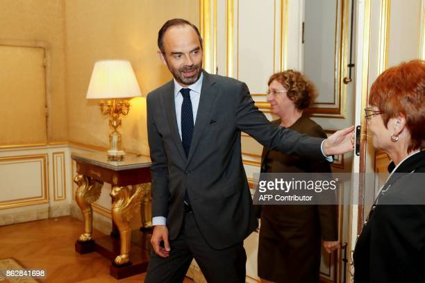 French Prime Minister Edouard Philippe and French Minister of Labour Muriel Penicaud arrives at the Hotel Matignon in Paris on October 18 for talks...