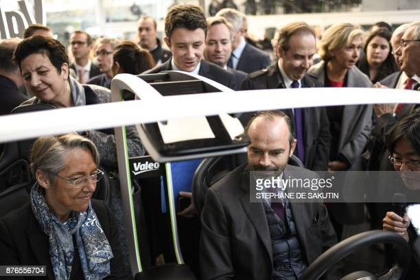 French Prime Minister Edouard Philippe and French Transports Minister Elisabeth Borne sit in a car next to French Minister of Higher Education...