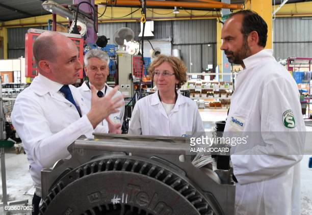 French Prime Minister Edouard Philippe and Minister of Labour Muriel Penicaud listen on during their visits to a plant that manufactures...
