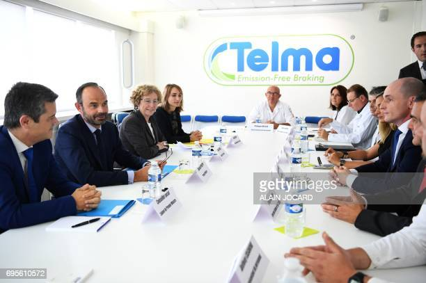 French Prime Minister Edouard Philippe and Minister of Labour Muriel Penicaud attend a meeting during their visit to the Telma plant that...