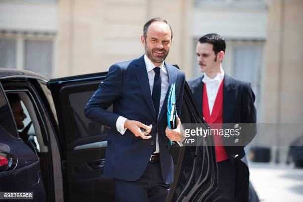 French Prime Minister Edouard Philippe arrives for a lunch with the French President at the Elysee Palace in Paris on June 20 2017 / AFP PHOTO / POOL...