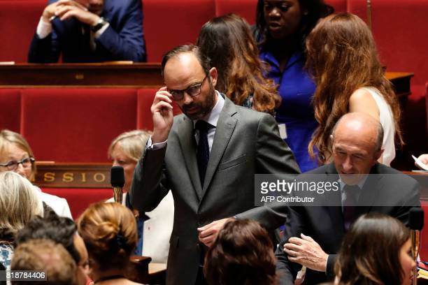 French Prime Minister Edouard Philippe arrives for a session of questions to the government at the French National Assembly in Paris on July 19 2017...