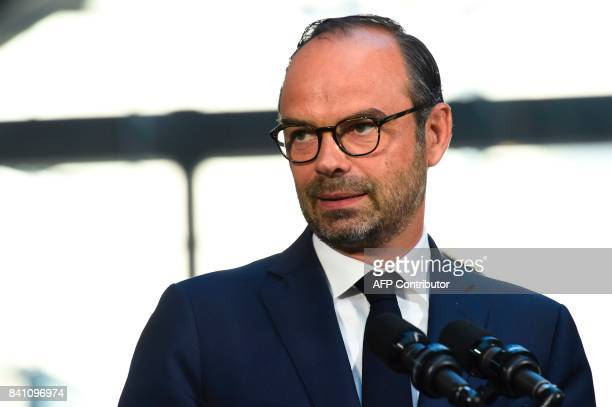 French Prime Minister Edouard Philippe delivers a speech during a visit at the startup incubator Station F in Paris on August 31 2107 / AFP PHOTO /...