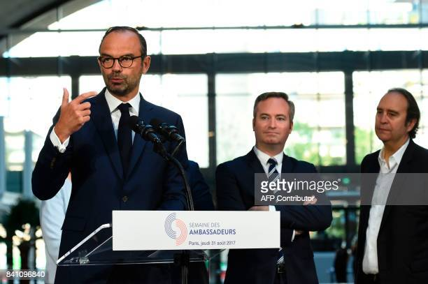 French Prime Minister Edouard Philippe delivers a speech next to Founder of French broadband Internet provider Iliad Xavier Niel during a visit at...