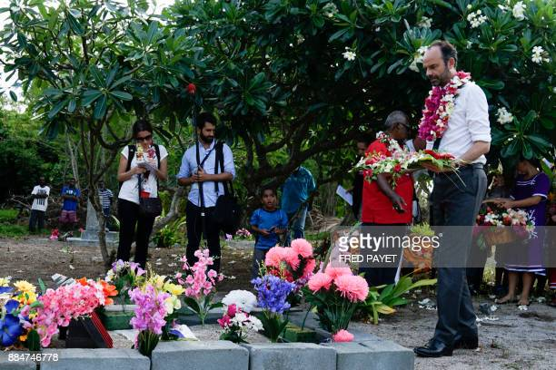 French Prime Minister Edouard Philippe deposits spray of flowers on the grave of the World War I infantryman Kalepo Wabete who died in northern...