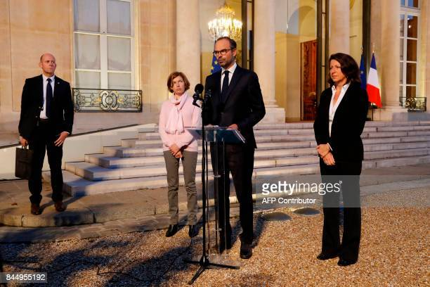 French Prime Minister Edouard Philippe flanked by French Minister for Solidarity and Health Agnes Buzyn and Defence Minister Florence Parly talks to...