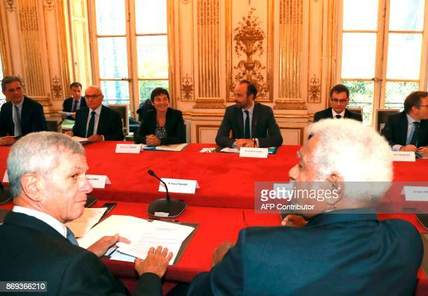 French Prime Minister Edouard Philippe flanked by French Overseas Minister Annick Girardin meet with Proindependence leader Roch Wamytan and French...