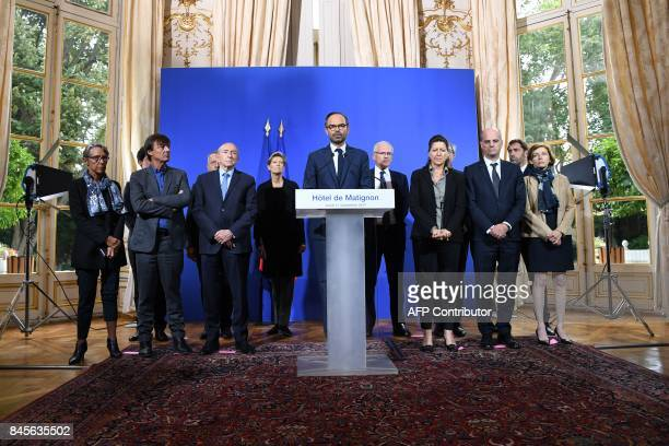 French Prime Minister Edouard Philippe flanked by his ministers speaks during a press conference at the Hotel Matignon in Paris on September 11 2017...