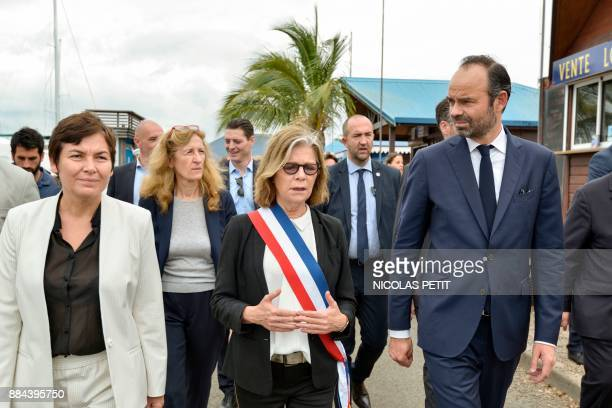 French Prime Minister Edouard Philippe flanked by mayor of Noumea Sonia Lagarde and Overseas Minister Annick Girardin walks in Noumea in the French...