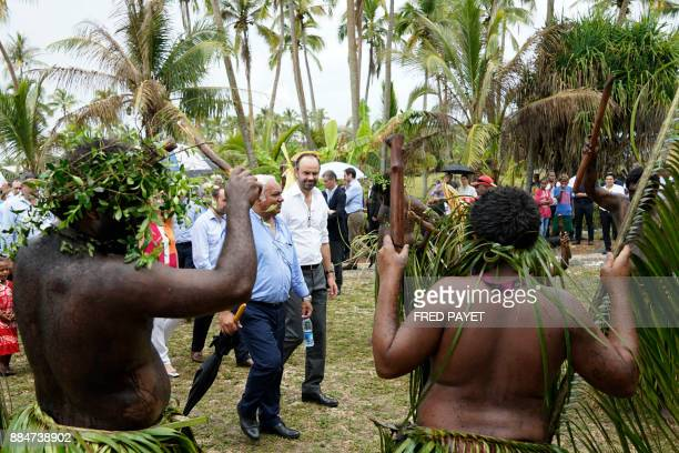 French Prime Minister Edouard Philippe flanked by President of the Loyalty Islands and mayor of Lifou Neko Hnepeune attends a welcoming ceremony at...