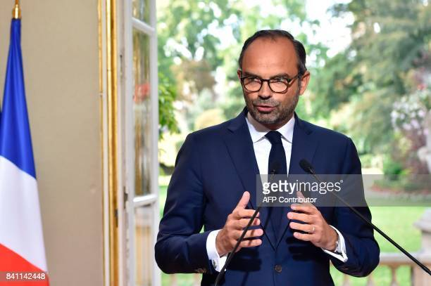 French Prime Minister Edouard Philippe gives a press conference after a meeting about the new labour code with representatives of French unions at...