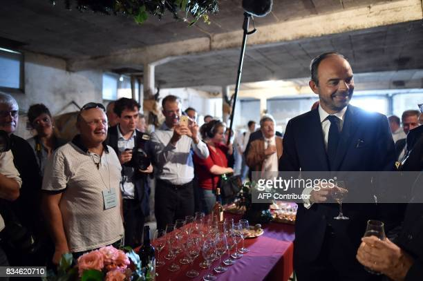 French Prime Minister Edouard Philippe holds a glass of armagnac during his visit to Domaine du Grand Comté in Roquelaure south western France on...