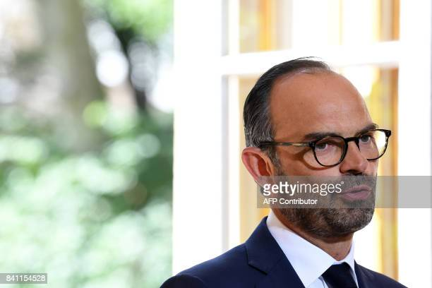 French Prime Minister Edouard Philippe holds a press conference after a meeting about the new labour law with representatives of French trade unions...