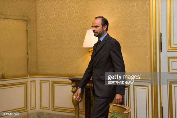 French Prime Minister Edouard Philippe is pictured within a meeting at the Hotel Matignon in Paris on October 17 as part of a day of talks with union...