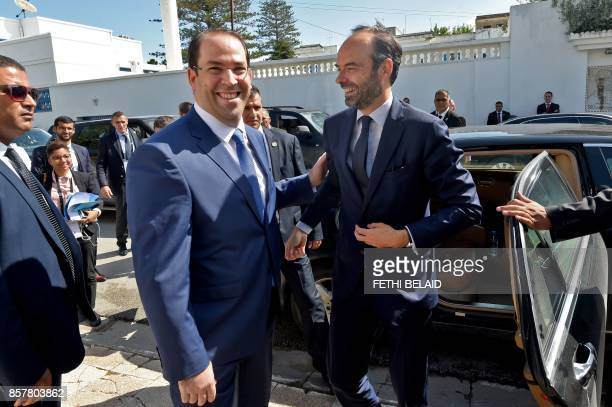 French Prime Minister Edouard Philippe is welcomed by his Tunisian counterpart Youssef Chahed on October 5 2017 in Tunis Philippe in on one day...