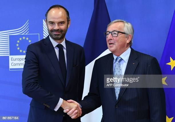 French Prime Minister Edouard Philippe is welcomed by the European Commission President JeanClaude Juncker in Brussels on October 16 2017 / AFP PHOTO...