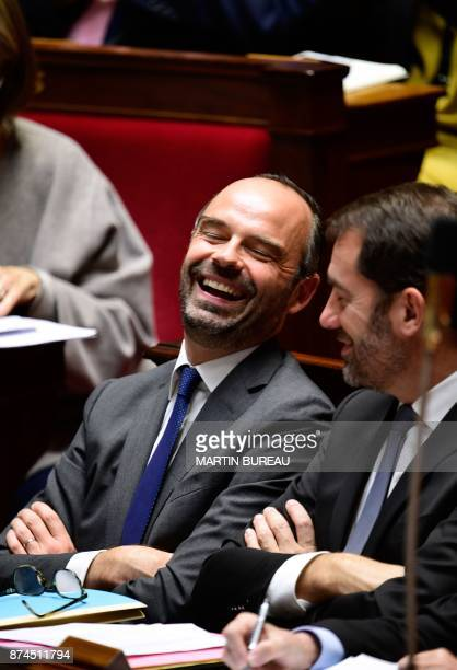 French Prime Minister Edouard Philippe laughs with French Junior Minister for the Relations with Parliament and Government Spokesperson Christophe...