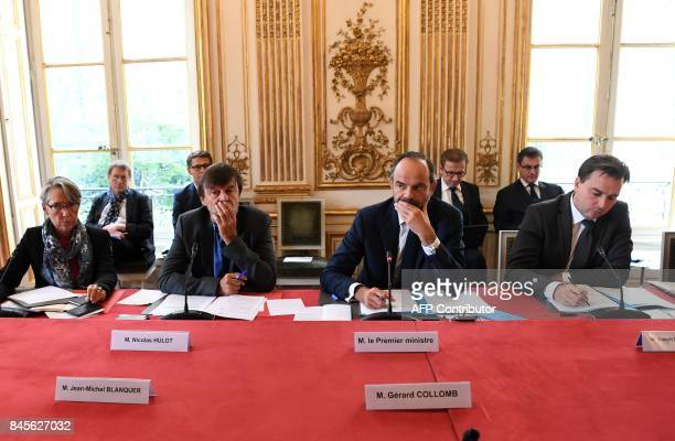 French Prime Minister Edouard Philippe leads a meeting with his cabinet director Benoit RibadeauDumas and his ministers including Minister for the...