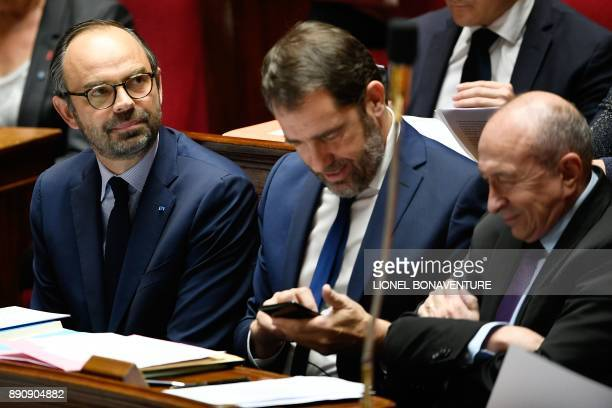 French Prime Minister Edouard Philippe looks on as he sits next to French Junior Minister for the Relations with Parliament Christophe Castaner and...