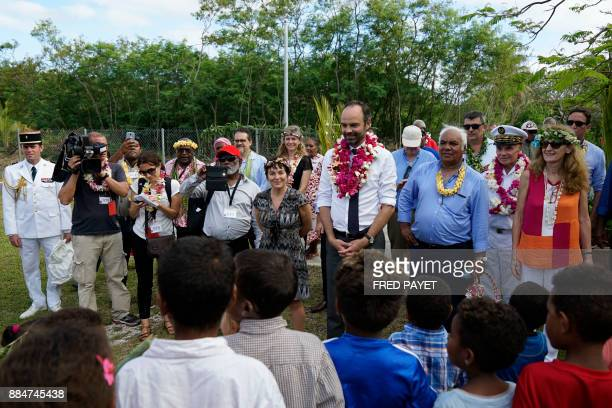 French Prime Minister Edouard Philippe meets pupils and teachers of the public school on Tiga island in the archipelago of the Loyalty Islands during...