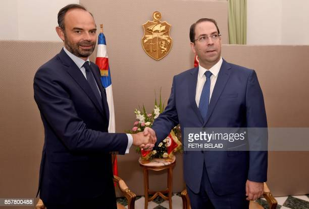 French Prime Minister Edouard Philippe meets with his Tunisian counterpart Youssef Chahed on October 5 2017 in Tunis Philippe in on one day official...