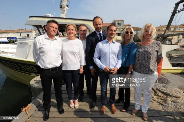 French Prime Minister Edouard Philippe poses with La Republique en marche party's candidate in the Gard Philipe Berta Françoise Dumas Olivier...