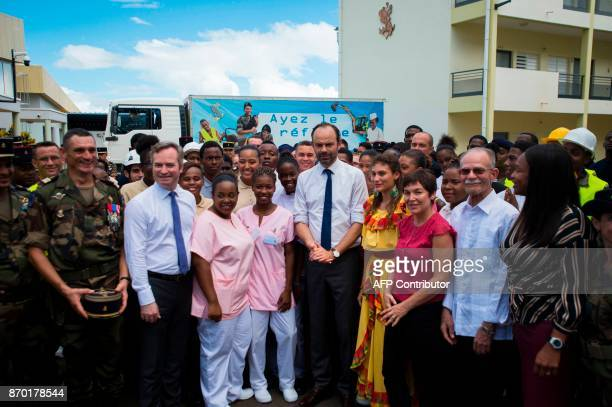 French Prime Minister Edouard Philippe poses with people working and training at the RSMA station in Le Lamentin on the French Caribbean island of...