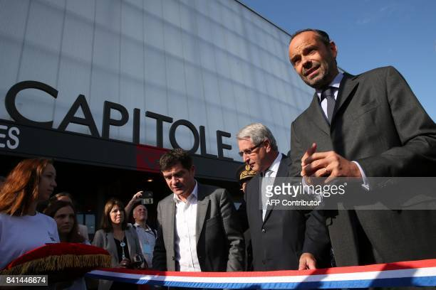 French Prime Minister Edouard Philippe prepares to cut the ribbon next to ChalonsenChampagne mayor Benoist Apparu and Grand Est regional council...