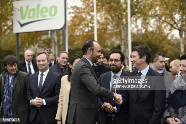French Prime Minister Edouard Philippe salutes French Minister for the Ecological and Inclusive Transition Nicolas Hulot French Junior Minister for...
