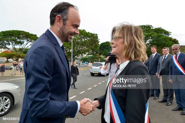 French Prime Minister Edouard Philippe shakes hands with Noumea's mayor Sonia Lagarde upon his arrival place BirHakeim in Noumea in the French...