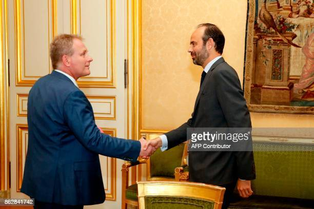 French Prime Minister Edouard Philippe shakes hands with President of the CFECGC union Francois Hommeril at the Hotel Matignon in Paris on October 18...