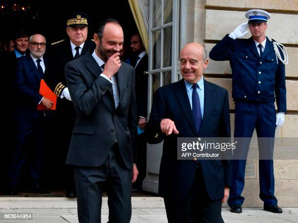 French Prime Minister Edouard Philippe shares a light moment with former Prime Minister and current Mayor of Bordeaux Alain Juppe as they walk at The...