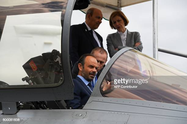 French Prime Minister Edouard Philippe sits in a Dassault Aviation Rafale fighter jet during a visit to the International Paris Air Show in Le...